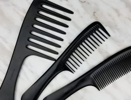Detangling 4c hair with a comb. The three seamless combs of different widths