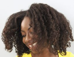 From A to 4z wearing a twist out to celebrate her natural hair journey